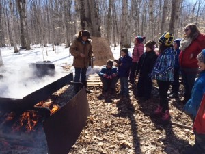 This giant fire boils the sap into syrup! It takes a lot of wood!