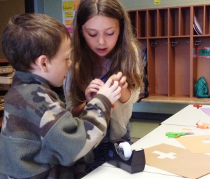 Sienna taught us how to make paper cubes. What a great math lesson!